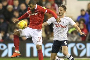 Ben Davies challenges Lewis Grabban in the game between PNE and Nottingham Forest at the City Ground earlier in the season