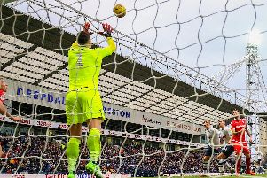 Jordan Storey looks on as Costel Pantilimon makes a save at Deepdale on Saturday