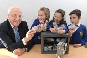 Bank of England North West agent John Young with pupils at Eldon Primary School where they have their own
