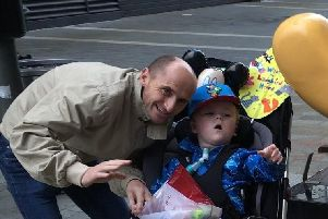 Jude, pictured in his borrowed buggy and Dad Damien