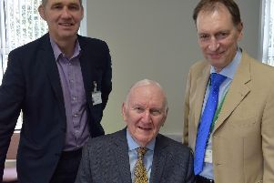 Andrew Mather, centre, with John Chesworth, left, Chairman of the Board of Trustees at St Catherines Hospice, and Stephen Greenhalgh, Chief Executive of St Catherines Hospice.