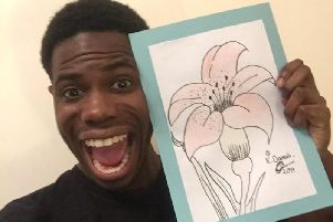 Apprentice 2018 candidate Kayode Damal with the artwork her drew for the auction