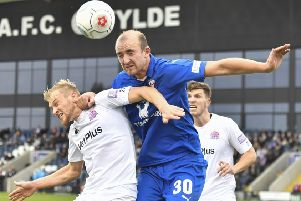Chesterfield's Tom Denton wins a header: Picture by Steve Flynn/AHPIX.com, Football: The Emirates FA Cup - Qualifing Fourth Round match AFC Fylde -V- Chesterfield at Mill Farm, Wesham, Lancashire, England on copyright picture Howard Roe 07973 739229