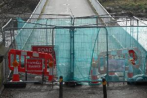 A cyclist has established a pressure group to make sure a key bridge in a popular Victorian city park is reopened.