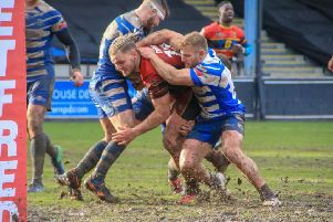Dewsbury's Kyle Trout is held short of the line by the Halifax defence following a fierce run as the Rams were kept pointless onbtheir trip to The Shay. Picture: Simon Hall, OMH Rugbypics