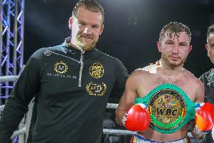 Isaac Lowe celebrates victory in Essex on Saturday night with trainer Ben Davison . Picture: Scott Rawsthorne for MTK Global