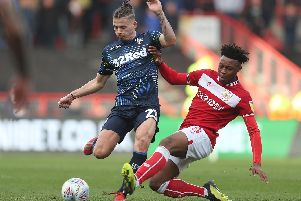 Leeds United's Kalvin Philips is tackled by Bristol City's Antoine Semenyo