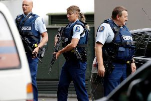 Armed police patrol outside a mosque in central Christchurch, New Zealand, Friday, March 15, 2019. A witness says many people have been killed in a mass shooting at a mosque in the New Zealand city of Christchurch.