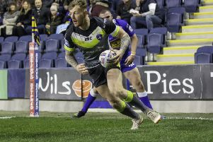 Tom Johnstone scores one of his three tries against Leeds Rhinos earlier this month. Picture by Isabel Pearce/SWpix.com.