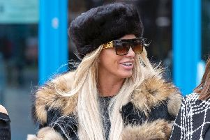Katie Price leaves Crawley Magistrates' Court where she appeared on two counts of using threatening, abusive, words or behaviour to cause harassment, alarm or distress.