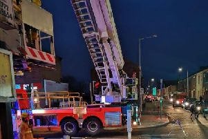 Firefighters from Preston used a 100 ft ladder to rescue a man from a flat in New Hall Lane on Thursday, March 21 after a suspected heart attack.