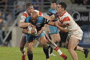 NO WAY THROUGH: Jamie Jones Buchanan is wrapped up by the Catalans defence. Picture: Pascal Rodriguez/RLphotos.com