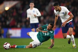 Preston loanee Lukas Nmecha, playing for Germany Under-21s, slides to win the ball ahead of England's Jake Clarke-Slater at Bournemouth (Getty Images)