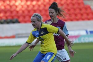 Chloe Peplow (yellow) in action for Doncaster Rovers Belles vs Aston Villa.