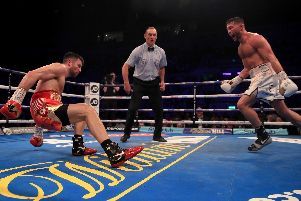 Scott Fitzgerald can't contain his delight after sending Anthony Fowler crashing to the canvas