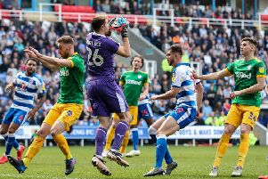 Louis Moult and Jordan Storey in the thick of the action as Reading keeper Emi Martinez gathers the ball