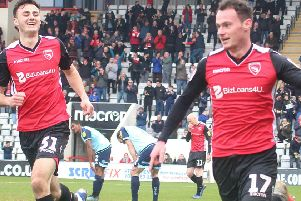 Morecambe's Liam Mandeville celebrates his winner against Crawley Town