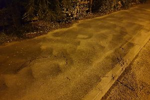 Dust gathered on the pavement opposite the new Morris Homes development in Penwortham - outside existing properties