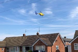 The air ambulance over the rooftops of Longton on Saturday morning