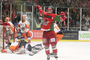Joey Martin skates away to celebrate after scoring one of his three goals against Sheffield Steelers. Picture: EIHL/Cardiff Devils.