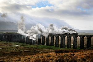 The Winter Cumbrian Mountain Express steams over the Ribblehead Viaduct on the Settle Carlisle line.  Picture: Bruce Rollinson