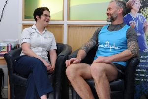 Jamie Peacock MBE, chats with physiotherapist Rhea Sutcliffe at Sue Ryder Wheatfields Hospice in Leeds 'Picture Tony Johnson.