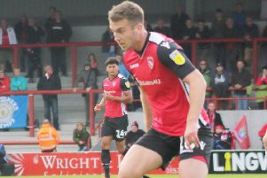 Morecambe's Rhys Oates is a doubt for tomorrow's match with Grimsby Town