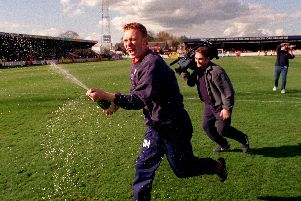 Preston manager David Moyes celebrates his side's Second Division title-win at Cambridge in April 2000