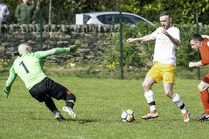 Crackenedge's James Goodall challenges Royston Cross golkeeper Joe Meecham during Saturday's Jim Callaghan Cup semi-final. Pics: Allan McKenzie