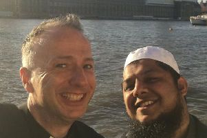 Friends Mark Umpleby and Irfan Soni share a smile on a recent trip to London.