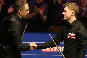 James Cahill, right, shakes hands with Ronnie O'Sullivan after beating the five-time world champion
