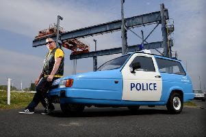 Graham Robinson's charity Reliant Robin 'police car' (Images: JPIMedia)