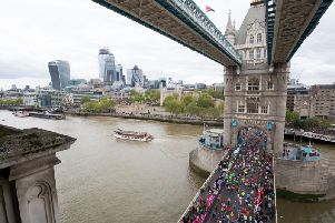 More than 1bn has now been raised by runners taking part in the London Marathon since it was first held in 1981. Here, runners are pictured crossing Tower Bridge. Picture by Aaron Chown/PA Wire.