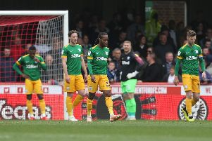 Preston North End players look dejected after conceding the first goal at Brentford