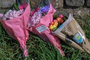 Flowers left close to the scene where Alex was found