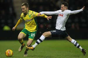 Preston North End's Alan Browne battles with  Norwich City's Tom Trybull