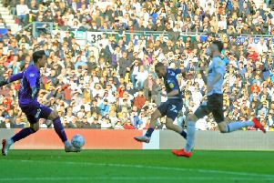 WINNER: Leeds United striker Kemar Roofe tucks away the only goal of the game in Saturday evening's Championship play-off semi-final first leg at Derby County. Picture by Tony Johnson.