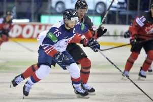 Robert Dowd battles for posession against Canada at the Steel Arena in Kosice. Picture: Dean Woolley.