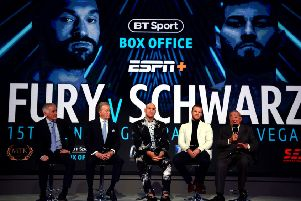 Tyson Fury (centre) with (from left to right) commentator John Rawling, promoter Frank Warren, trainer Ben Davison and promoter Bob Arum at Monday's press conference