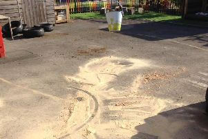 "Th bword ""sorry"" was left scrawled in this sand after vandals wrecked a reception play area at Garstang Community Primary School"