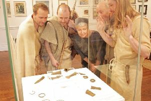 Living history group, The Iron Shepherds admire the newly acquired Scotforth hoard