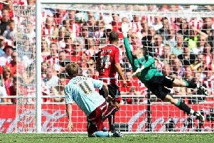 Wade Elliott watches his effort beat Paddy Kenny for the winner at Wembley