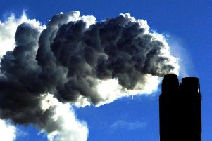 Leading climate scientists have called on Theresa May to swiftly put a target to cut greenhouse gas emissions to zero into national law.