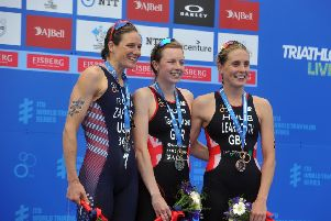 Georgia Taylor-Brown, centre, with  Jess Learmonth, right, and Katie Zaferes on the podium for the womens race.  Picture Tony Johnson.