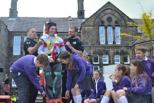 Pupils from Arkholme School watch as a student teacher is tied to a stretcher during rescue demonstration carried out by Lancaster Area Search and Rescue officer in charge (back left) Alex Bowden and probationer Dan Rawes (back right) at the flood awareness day held at the University of Cumbria campus in Bowerham Road, Lancaster on Thursday 6 June 2019