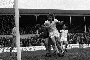 Preston striker Barrie Mitchell challenges the Chester goalkeeper at Deepdale in February 1977