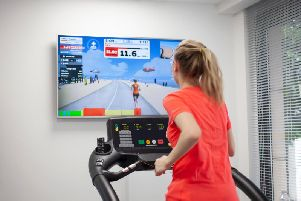 Liz Connor running on a treadmill, while testing out the Zwift running app. Phooto by PA