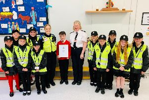 Zak, Dean receives his commendation from Supt Helen Anderson joined by PSCO Lisa Auld and Mini Police members.
