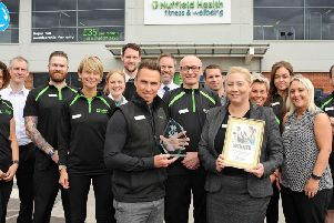 Richard Brand, the general manager of Nuffield Health Fitness and Wellbeing, and his deputy Elaine Topham,  with staff after they were presented with the trophy.
