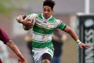 Danny Thomas scored a hat-trick of tries in Dewsbury Celtic's 38-6 victory over Eastmoor Dragons.